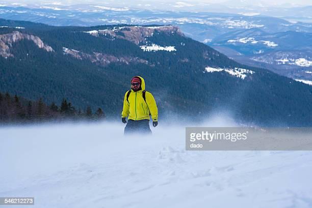 Man walking in mountains in winter