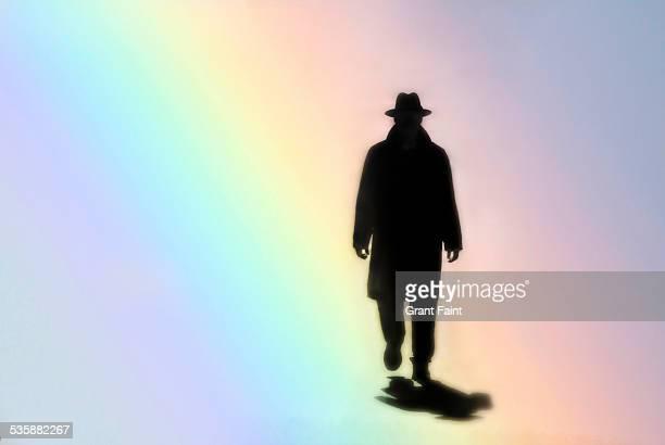 Man walking in rainbow