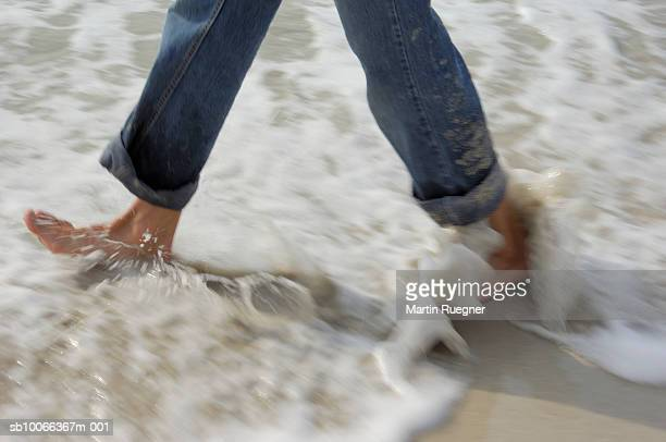 Man walking in surf, low section