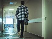 man walking in the hospital corridor alone