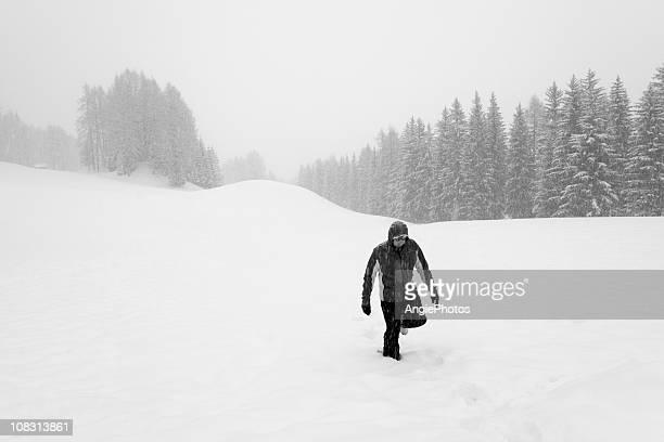 Man walking in the snow winter landscape