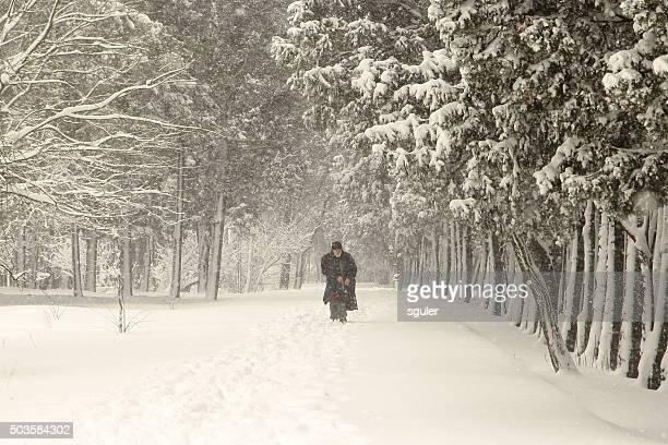 man walking in winter
