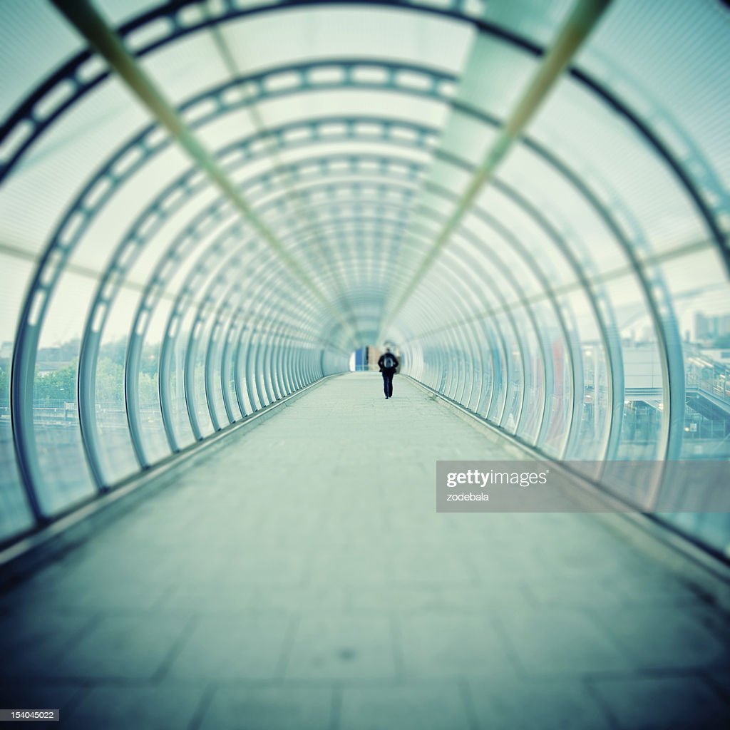 Man Walking inside Futuristic Tunnel, Tilt Shift