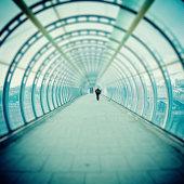 Man Walking inside Futuristic Tunnel, Tilt Shift