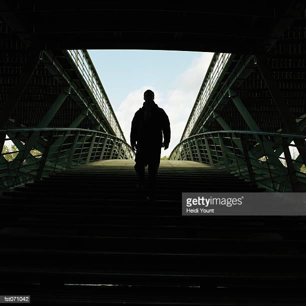 A man walking into a stadium