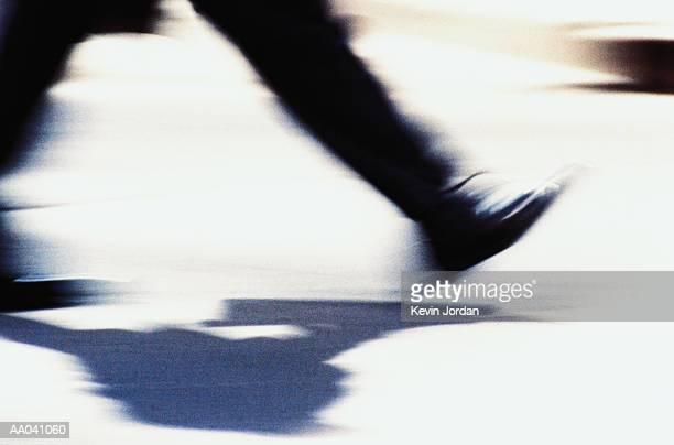 Man walking, low section (blurred motion)