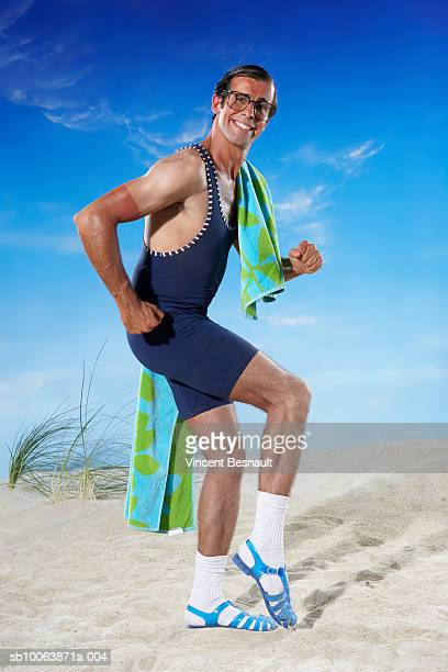 Man walking on beach, smiling, portrait