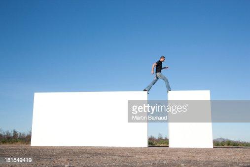 Man walking on blocks outdoors