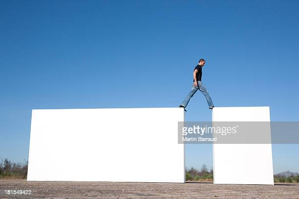 Man walking on blocks outdoors