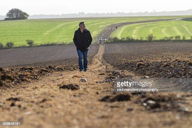 Man walking on country path