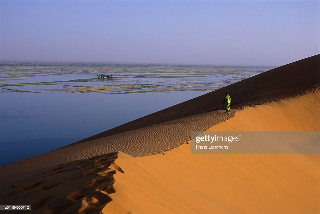 Man Walking on Dune