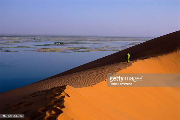 Man Walking on Dune