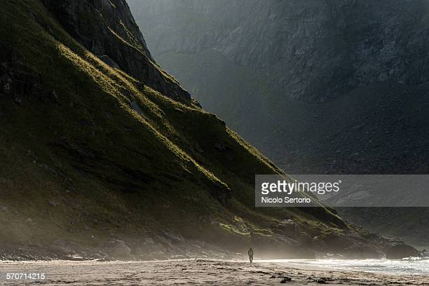 Man walking on Norwegian beach