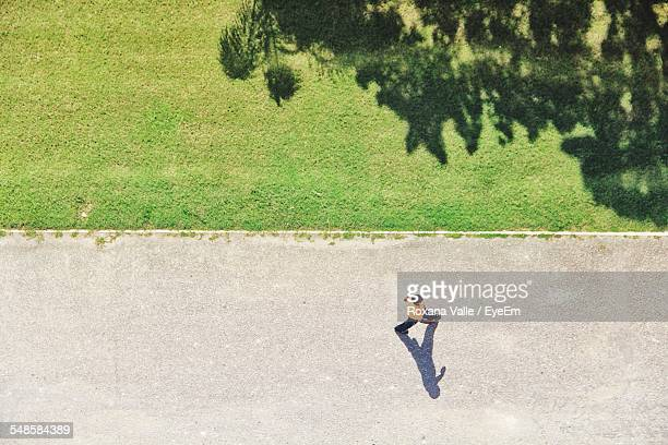 Man Walking On Park Alley