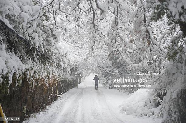 A man walking on snow road