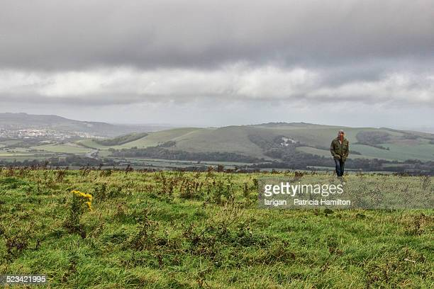 Man walking on South Downs on a blustery day