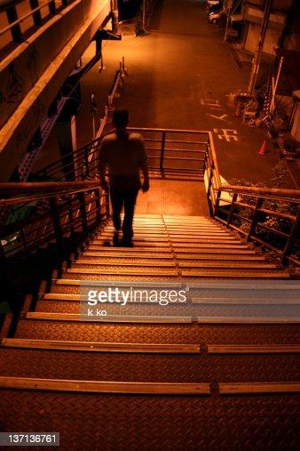 Man walking on stairs : Stock Photo