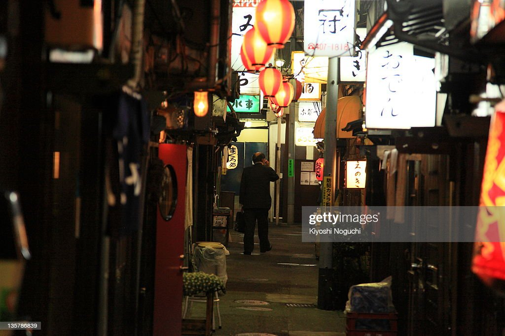 Man walking on street while talking on phone : Stock Photo