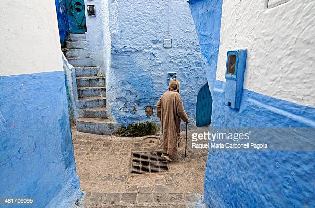 Man walking on the blue streets of the medina