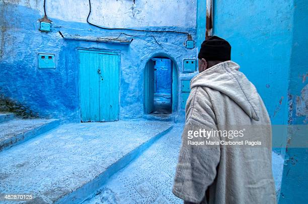 Man walking on the blue streets