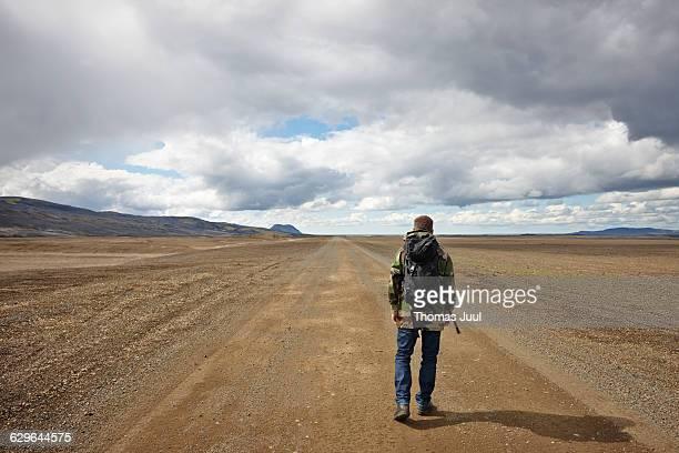 Man walking on the dirt road