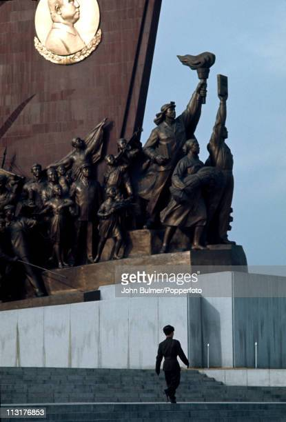 A man walking past the Mansudae Grand Monument which depicts the North Korean revolutionary struggle Pyongyang North Korea February 1973