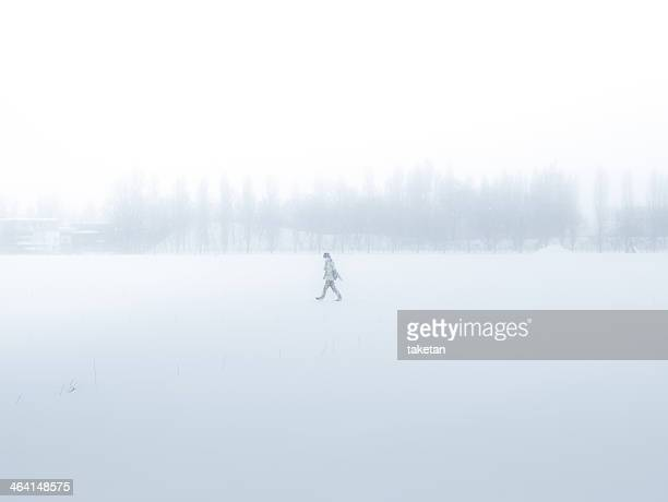 Man walking through a snowfield