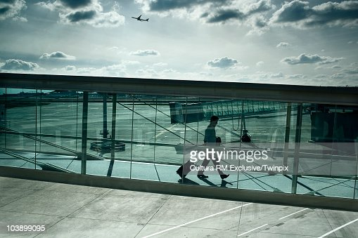 Man walking through airport walkway