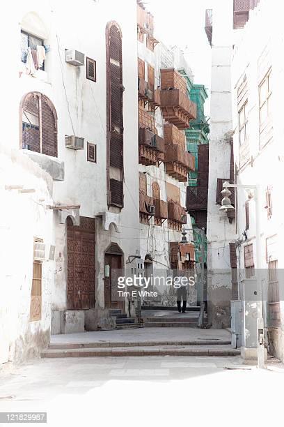 Man walking through city street, Al-Balad, Old town, Jeddah, Saudi Arabia, Middle East