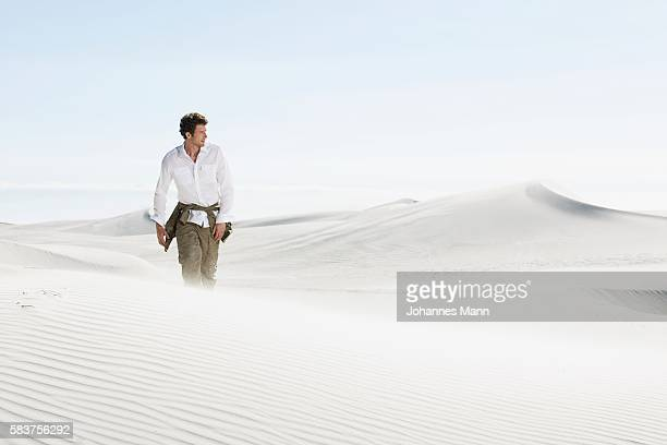 Man Walking Through Desert
