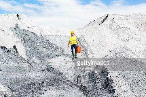 Man walking through industrial site