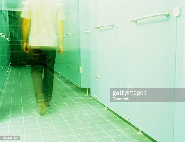 Man Walking Through Locker Room