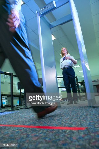 Jew Detector: Man Walking Through Metal Detector At Airport Stock Photo