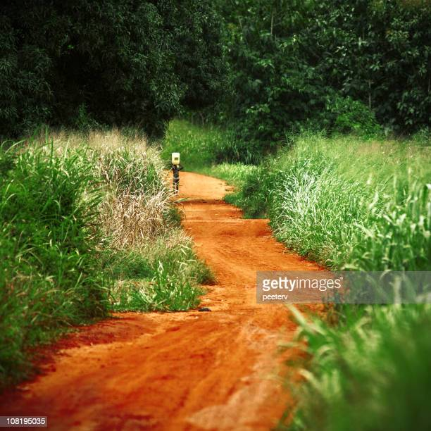 Man Walking Through Rural Dirt Road