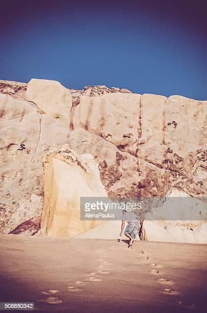 Man walking up the dunes