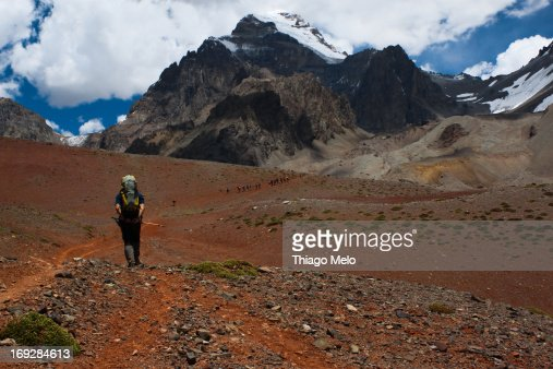 Man walking with Aconc?gua mount in the background : Stock Photo