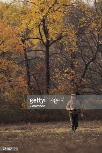 Man walking with binoculars : Stock Photo
