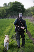Man walking with dog in field