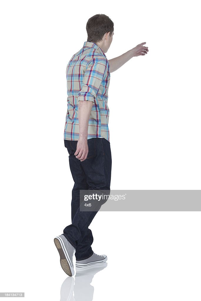 man walking with pointing forward