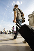 Man walking with rolling luggage