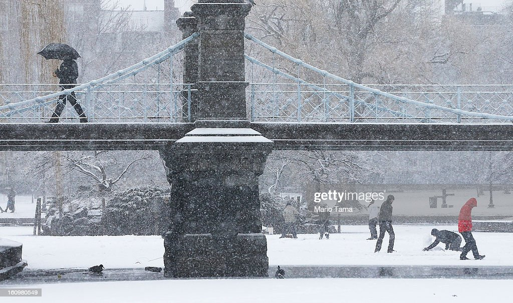 A man walks across a bridge in the snow in the Public Garden on February 8, 2013 in Boston, Massachusetts. Massachusetts and other states from New York to Maine are preparing for a major blizzard with possible record amounts of snowfall in some areas.