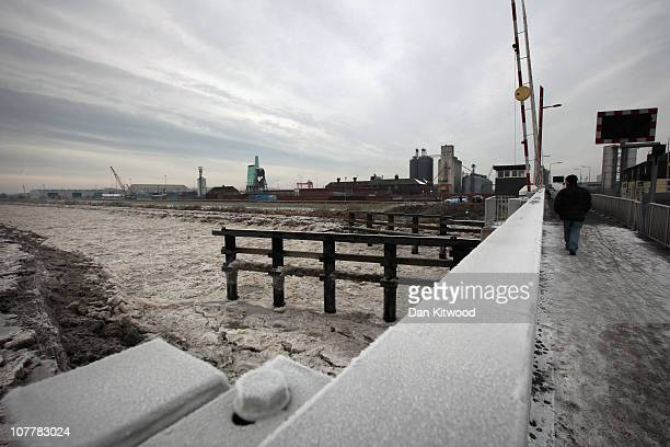 A man walks across a bridge over the frozen River Don on December 26 2010 in Goole England Freezing weather is continuing to grip much of the country...