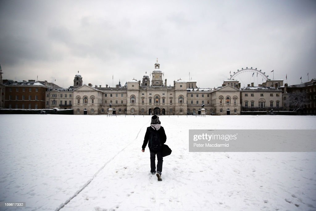 A man walks across a snowy Horse Guards Parade on January 21, 2013 in London, England. The United Kingdom has suffered a weekend of heavy snowfall with many transport routes affected.