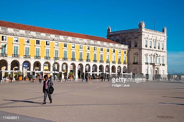 Man walks across Praca do Comercio square