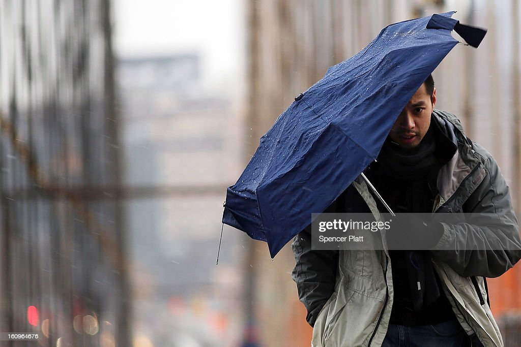 A man walks across the Brooklyn Bridge in the snow and sleet in the early hours of a major winter storm on February 8, 2013 in New York City. New York City and much of the Northeast is expected to get a foot or more of snow through Saturday afternoon with possible record-setting blizzard conditions expected in Boston, Massachusetts. Heavy snow warnings are in effect from New Jersey through southern Maine.