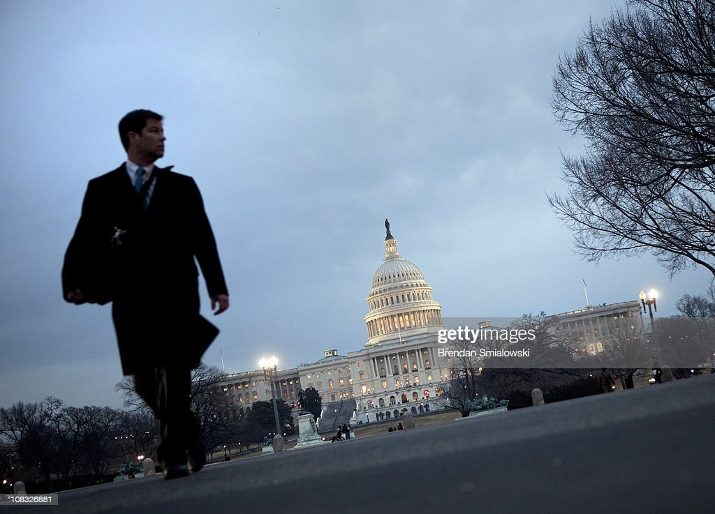 A man walks across the street from the US Capitol's rotunda before the State of the Union address on Capitol Hill January 25 2011 in Washington DC...