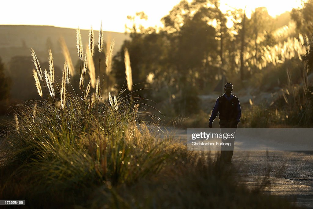 A man walks along 17 Shaft Road at Crown Mines where trees and vegetation have been planted to prevent erosion of the old mine dumps on July 16, 2013 in Johannesburg, South Africa. Johannesburg became the centre of gold mining in 1886 when gold was first discovered. Two government officials were sent to establish a settlement and named it Johannesburg after the first name they both shared. The gold rush lasted for over 100 years. The South African mining industry has shed more than 340,000 jobs since 1990 but is still the fifth largest gold producer in the world and has vast amounts of other minerals still to be unearthed.