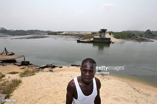A man walks along a polluted waterway in Bodo Nigeria Wednesday Jan 13 2016 Twenty years after the oilpollution crisis in the Niger delta shot to...