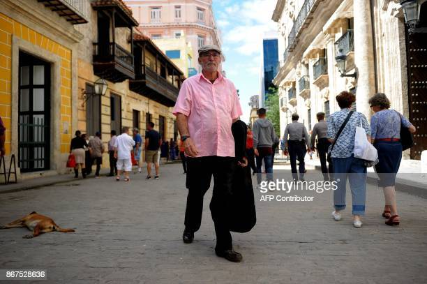 A man walks along a street in Havana on October 27 2017 Almost drowned by the crisis of the 90s the emerging Cuban fashion begins to thrive boosted...