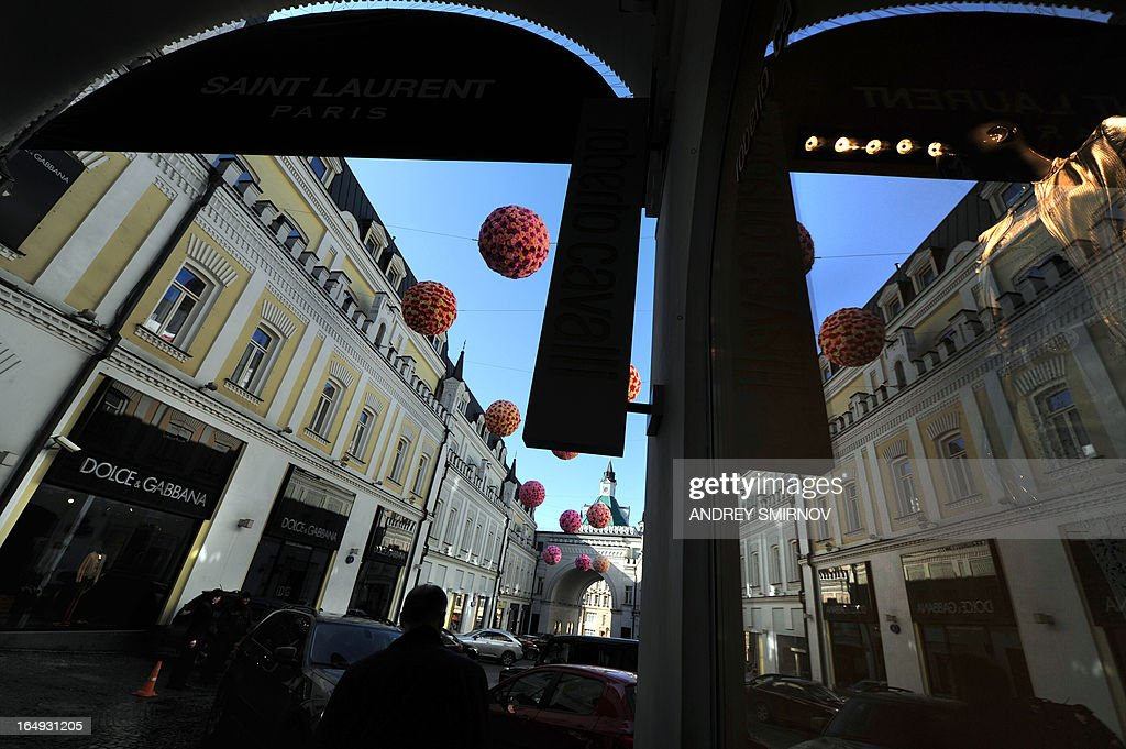 A man walks along a street of expensive boutiques, Tretyakovsky passage in central Moscow on March 29, 2013.
